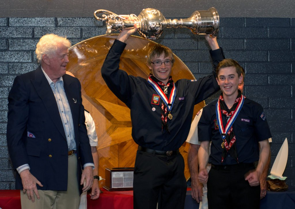 Team New Zealand members Nicholas Gardiner, (c), and Nicholas Williams, (r), win the Koch Cup. William Koch,(l), the name sake of the Sea Scout Cup, presents the cup during an awards banquet at the Long Beach Yacht Club.
